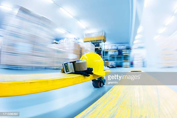Speeding forklift in the busy warehouse