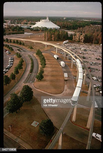 A speeding monorail travels across the parking lot to several Walt Disney World attractions such as Future World the Magic Kingdom River Country and...