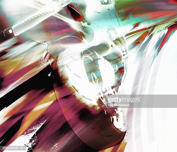 Speeding motorcycle, close-up