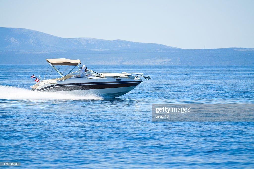 speeding power boat