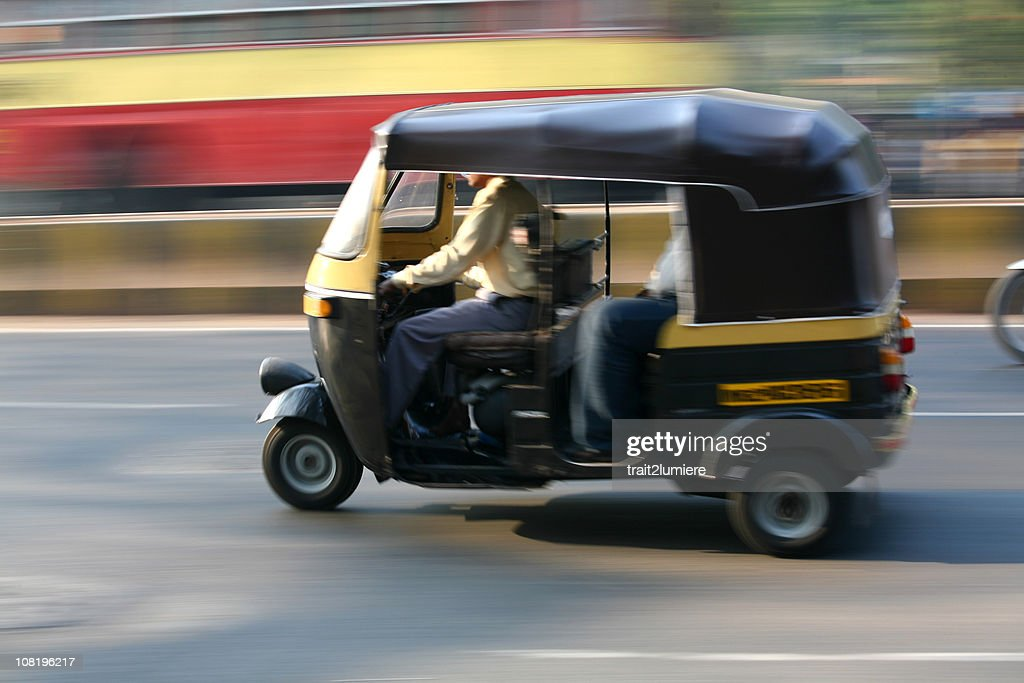 Speeding rickshaw : Stock Photo