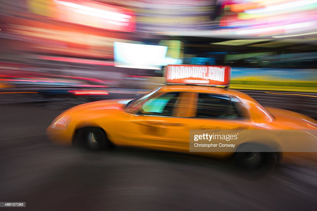 CONTENT] A speeding taxi cab in Times Square,New York,commuting,rush hour,movement,pace of life,hectic,busy,people,manhattan,NYC,blur,taxi,cab,yellow cab,broadway,times square