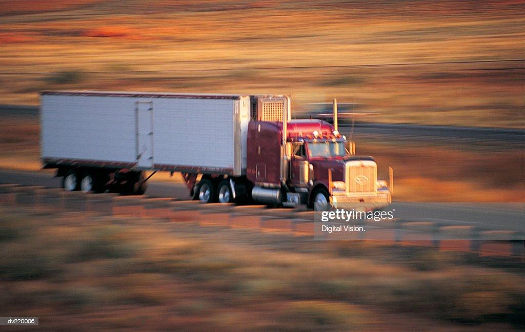 Speeding truck with blurred scenery : Stock Photo