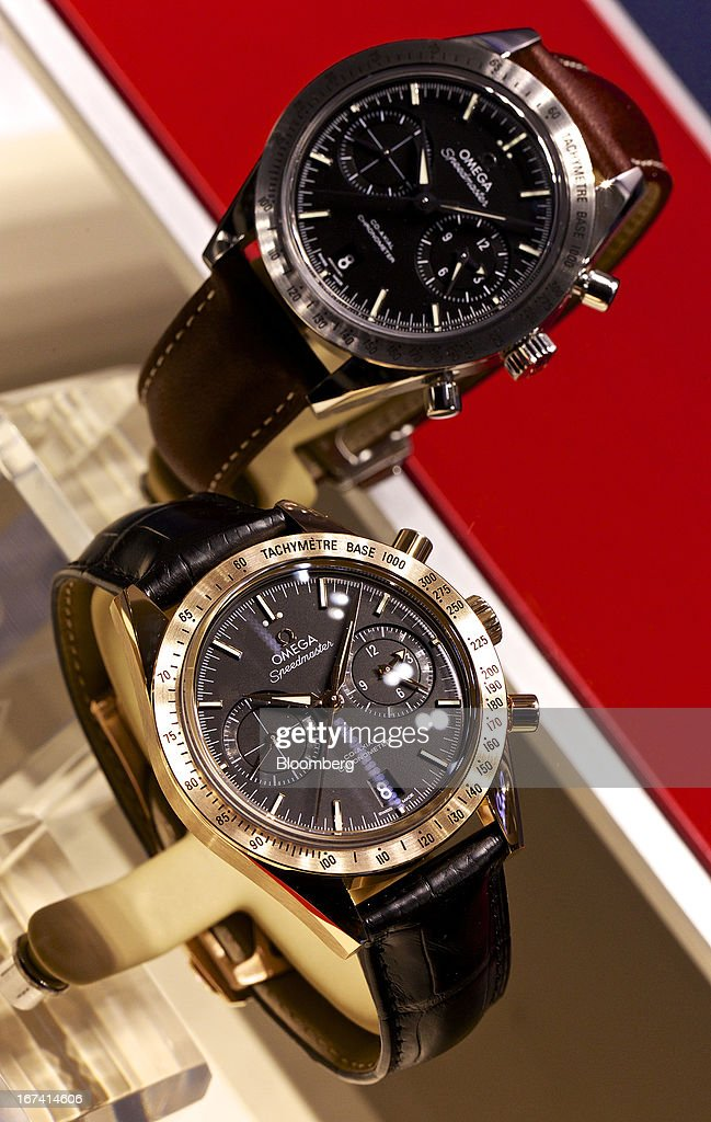 Speedmaster wristwatches manufactured by Omega, a unit of Swatch Group AG, sit on display during the Baselworld watch fair in Basel, Switzerland, on Wednesday, April 24, 2013. The annual fair attracts 2,000 companies from the watch, jewelry and gem industries to show their new wares to more than 100,000 visitors. Photographer: Gianluca Colla/Bloomberg via Getty Images