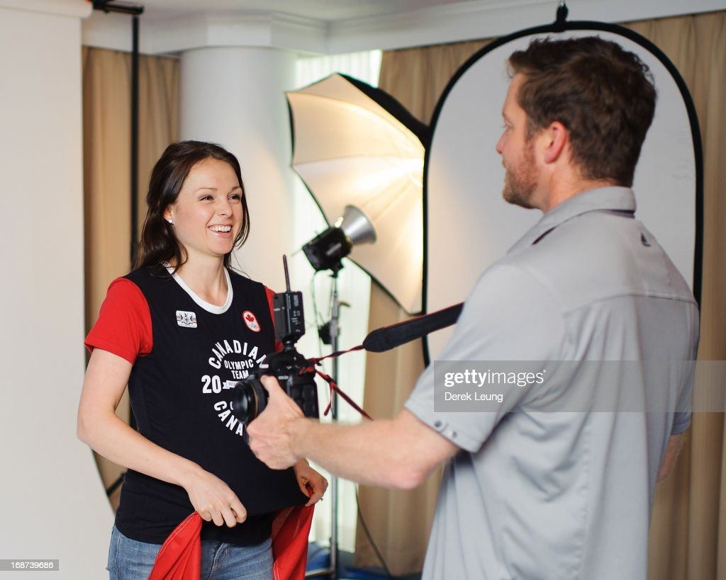 Speed-skater Gabrielle Waddell shares a laugh with photographer Jonathan Ferrey (R) as her portrait is taken during the Canadian Olympic Committee Portrait Shoot on May 13, 2013 in Vancouver, British Columbia, Canada.