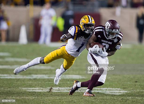 Speedy Noil of the Texas AM Aggies makes a catch as Donte Jackson of the LSU Tigers makes the tackle in the second half at Kyle Field on November 24...