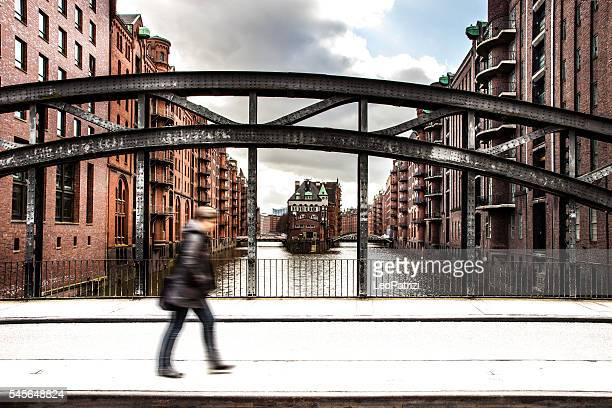 Speicherstadt in Hamburg with a person passing by