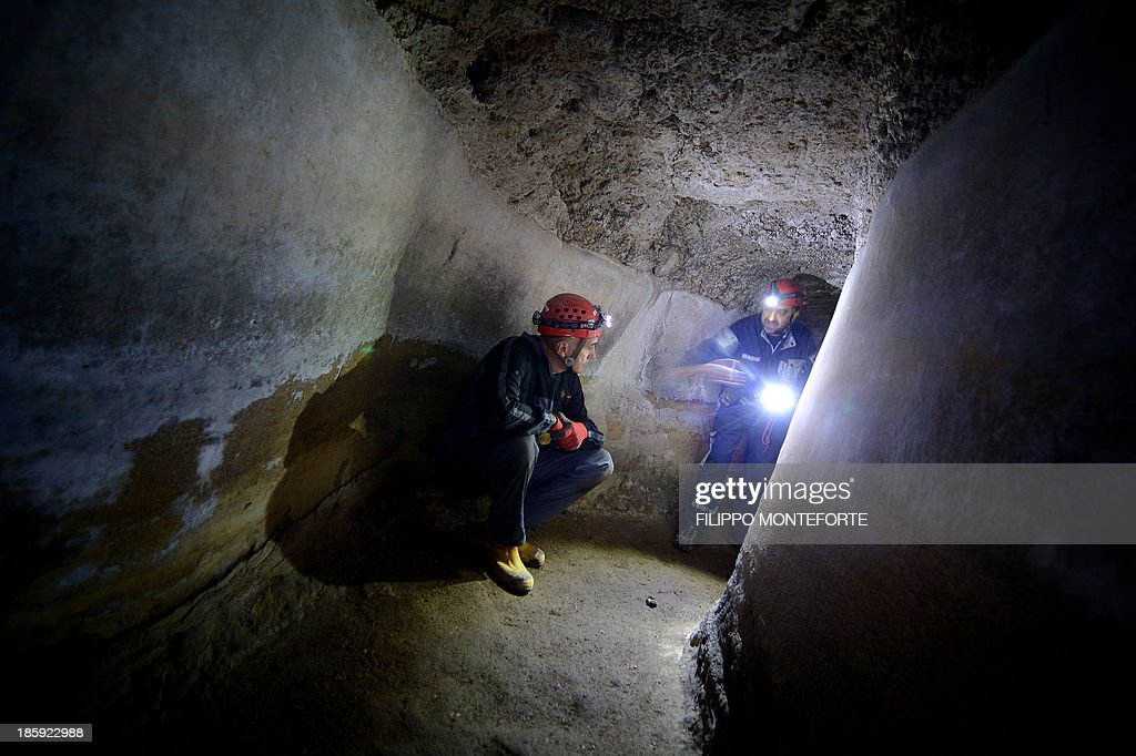 THUBURN - 'Speleo-archaeologists' make their way through a perfectly preserved tunnel section of the Acqua Claudia on the grounds of a Franciscan convent in Vicovaro 60 km out of Rome on September 28, 2013. A group of speleologists is completing the first ever mapping of the 11 aqueducts that supplied ancient Rome that still run for hundreds of kilometres underground and along stunning viaducts. Helped with modern technologies they map the network compiled at the beginning of the 20th century by British Roman archaeologist Timothy Ashby between 1906 and 1925. AFP PHOTO/Filippo MONTEFORTE