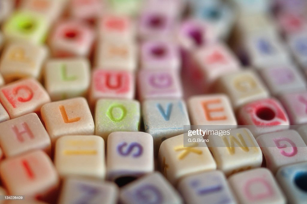 LOVE spelled out with colorful dices : Stock Photo