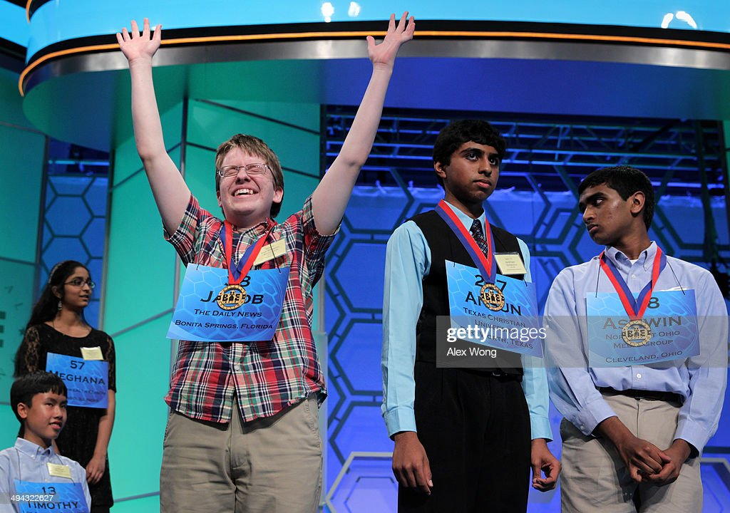 Speller Jacob Daniel Williamson (L) of Cape Coral, Florida, celebrates after he has advanced to the final rounds of the 2014 Scripps National Spelling Bee competition May 29, 2014 in National Harbor, Maryland. Twelve spellers have advanced to the finals to compete for the top honor in the annual spelling contest.