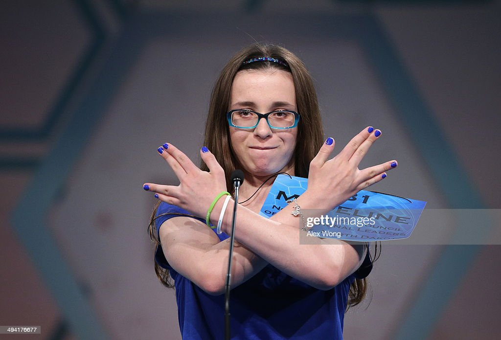 Speller Madeline Rickert of Minot, North Dakota, gestures after she correctly spelled her word during round three of the 2014 Scripps National Spelling Bee competition May 28, 2014 in National Harbor, Maryland. More than 250 spellers from the U.S. and seven other countries gathered to compete for the top honor in the annual spelling contest.