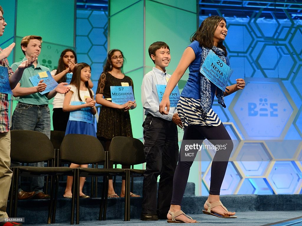 Speller Neha Konakalla, of Cupertino, Calif., right, heads toward the stage upon being named a finalist for the 2014 Scripps National Spelling Bee in National Harbor, Md., Thursday, May 29, 2014.