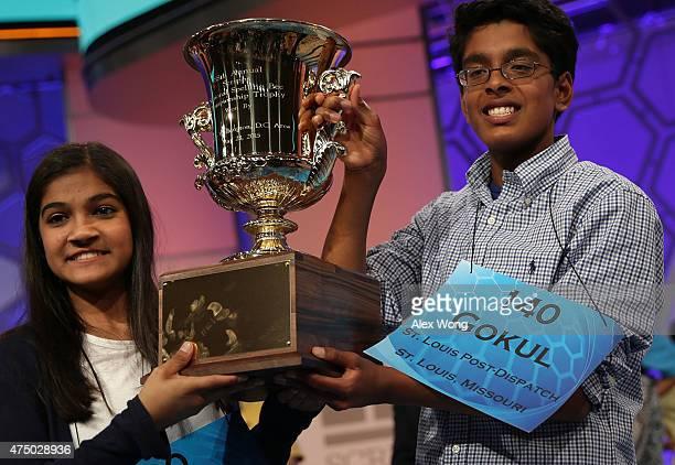HARBOR MD MAY 28 Speller Vanya Shivashankar of Olathe Kansas and speller Gokul Venkatachalam of St Louis Missouri hold up the trophy after winning...