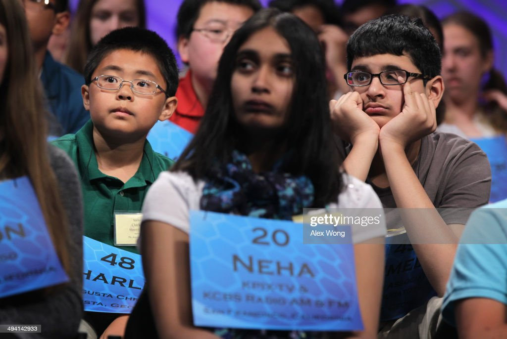 Spellers Charles Sirui Li (L) of Martinez, Georgia and Sumedh Garimella (R) of Duluth, Georgia, watch as they wait for their turns during round two of the 2014 Scripps National Spelling Bee competition May 28, 2014 in National Harbor, Maryland. More than 250 spellers from the U.S. and seven other countries gathered to compete for the top honor in the annual spelling contest.