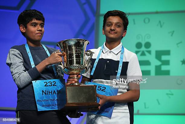 Spellers Nihar Saireddy Janga of Austin Texas and Jairam Jagadeesh Hathwar of Painted Post New York hold a trophy after the finals of the 2016...