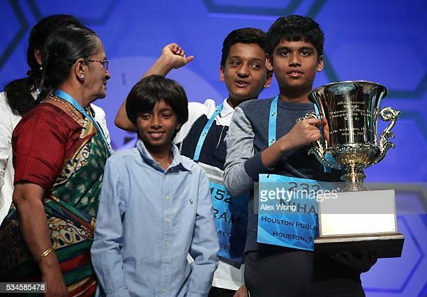 Spellers Nihar Saireddy Janga of Austin Texas and Jairam Jagadeesh Hathwar of Painted Post New York celebrate with family members after the finals of...