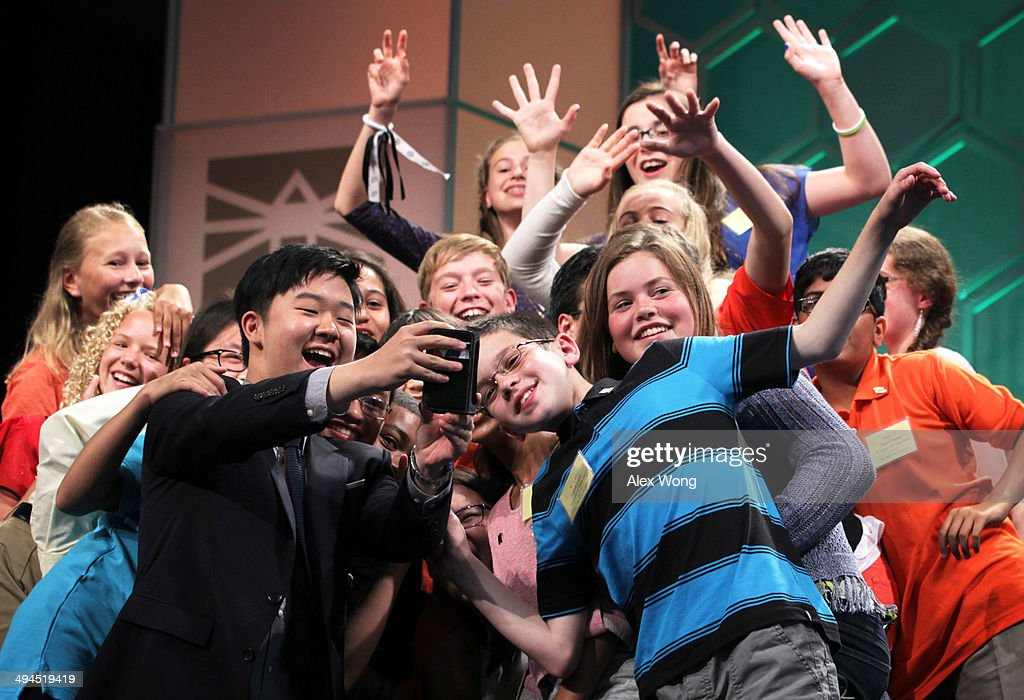 Spellers who have been eliminated from the competition take a selfie, also known as 'spellfie,' during a live broadcast commercial break of final rounds of the 2014 Scripps National Spelling Bee May 29, 2014 in National Harbor, Maryland. Hathwar and Sujoe were declared as co-champions after 22 rounds of the competition.