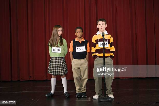 Spelling bee participants on stage