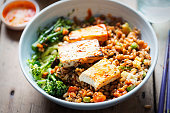 Spelt, broccoli, savoy cabbage with chargrilled tofu with sriracha