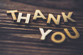 THANK YOU spelt out on wooden background
