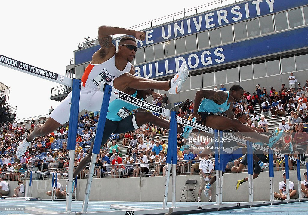 Spencer Adams (L) competes in the Men's 110 Meter Hurdles on day four of the 2013 USA Outdoor Track & Field Championships at Drake Stadium on June 23, 2013 in Des Moines, Iowa.