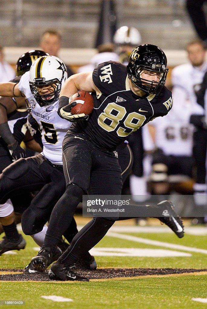 Spencer Bishop #89 of the Wake Forest Demon Deacons fields a short kick-off against the Vanderbilt Commodores at BB&T Field on November 24, 2012 in Winston Salem, North Carolina. The Commodores defeated the Demon Deacons 55-21.