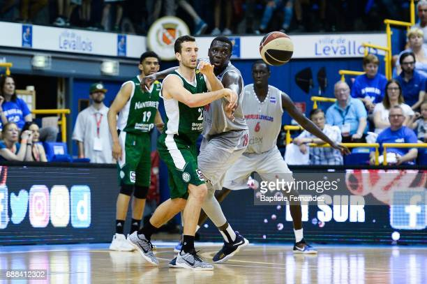 Spencer Butterfield of Nanterre 92 and Landing Sane of Paris Levallois during the Pro A Playoffs game 2 between Paris Levallois and JSF Nanterre on...
