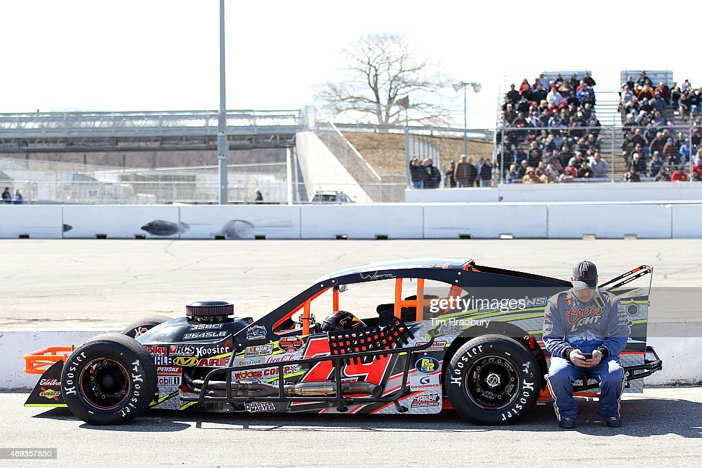 <a gi-track='captionPersonalityLinkClicked' href=/galleries/search?phrase=Spencer+Davis&family=editorial&specificpeople=929463 ng-click='$event.stopPropagation()'>Spencer Davis</a>, driver of the #79 Hillbilly Racing/Coors 21 Means 21 Pontiac, leans on his car in pit road during qualifying for the NASCAR Whelen Modified Tour - Icebreaker 150 at Thompson Speedway on April 11, 2015 in Thompson, Connecticut.