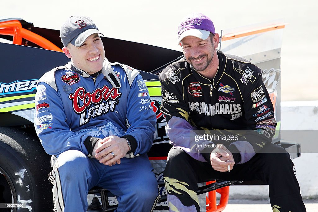 <a gi-track='captionPersonalityLinkClicked' href=/galleries/search?phrase=Spencer+Davis&family=editorial&specificpeople=929463 ng-click='$event.stopPropagation()'>Spencer Davis</a> (left), driver of the #79 Hillbilly Racing/Coors 21 Means 21 Pontiac, talks with Tom Rogers Jr., driver of the #63 East End Statuary Chevrolet, on pit road during qualifying for the NASCAR Whelen Modified Tour - Icebreaker 150 at Thompson Speedway on April 11, 2015 in Thompson, Connecticut.