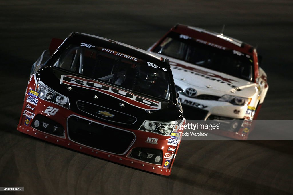 <a gi-track='captionPersonalityLinkClicked' href=/galleries/search?phrase=Spencer+Davis&family=editorial&specificpeople=929463 ng-click='$event.stopPropagation()'>Spencer Davis</a>, driver of the #20 Ruud Chevrolet, races Harrison Burton, driver of the #12 Dex Imaging Toyota, during the NASCAR K&N Pro Series West Casino Arizona 100 at Phoenix International Raceway on November 12, 2015 in Avondale, Arizona.