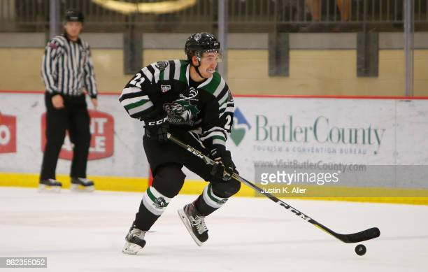 Spencer DenBeste of the Cedar Rapid RoughRiders skates with the puck during the game against the Sioux Falls Stampede on Day 2 of the USHL Fall...