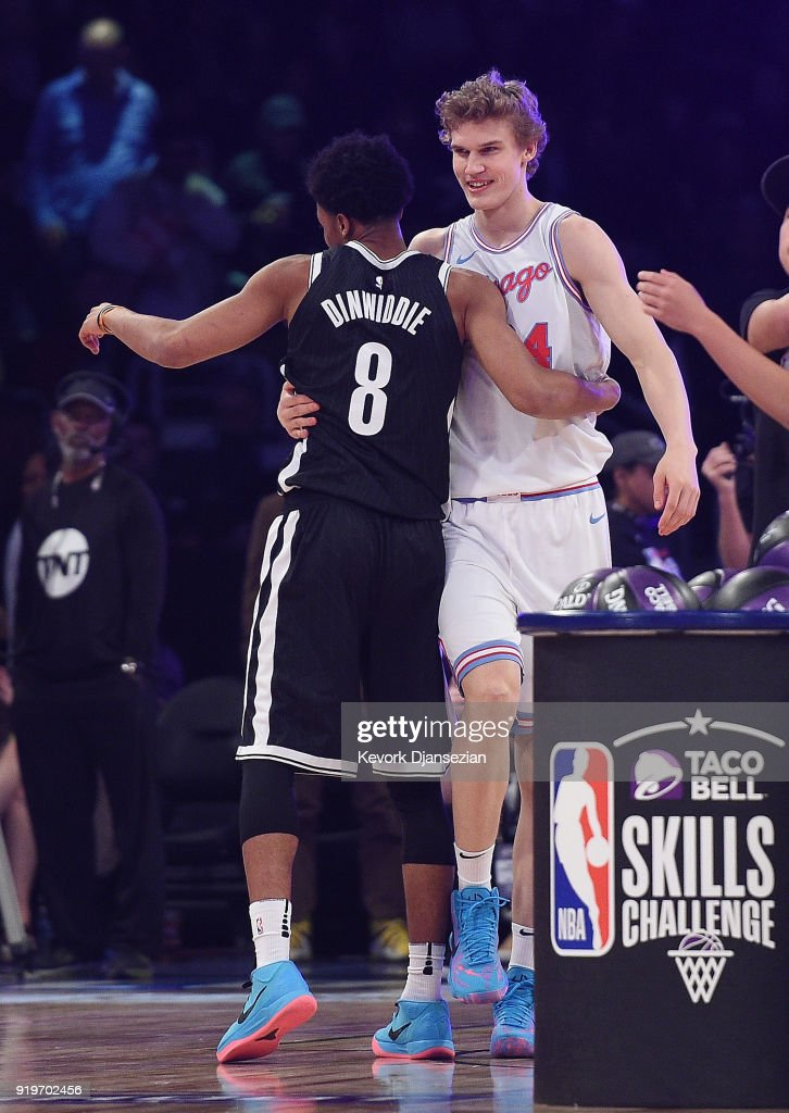 Spencer Dinwiddie #8 of the Brooklyn Nets and Lauri Markkanen #24 of the Chicago Bulls congratulate each other after competing in the 2018 Taco Bell Skills Challenge at Staples Center on February 17, 2018 in Los Angeles, California.