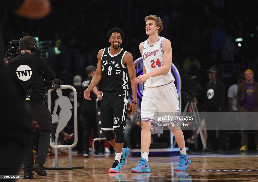 Spencer Dinwiddie #8 of the Brooklyn Nets and Lauri Markkanen #24 of the Chicago Bulls walk off the court after competing in the 2018 Taco Bell Skills Challenge at Staples Center on February 17, 2018 in Los Angeles, California.