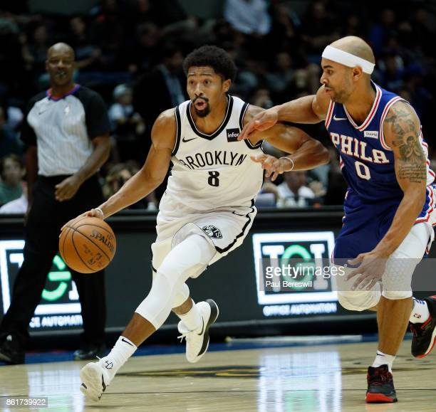 Spencer Dinwiddie of the Brooklyn Nets drives past Jerryd Bayless of the Philadelphia 76ers during a preseason NBA basketball game on October 11 2017...