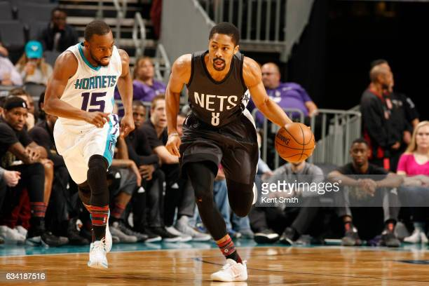 Spencer Dinwiddie of the Brooklyn Nets drives to the basket against Kemba Walker of the Charlotte Hornets during the game on February 7 2017 at...