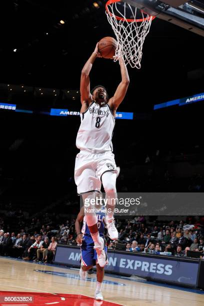 Spencer Dinwiddie of the Brooklyn Nets drives to the basket against the Philadelphia 76ers on October 11 2017 at Nassau Veterans Memorial Coliseum in...