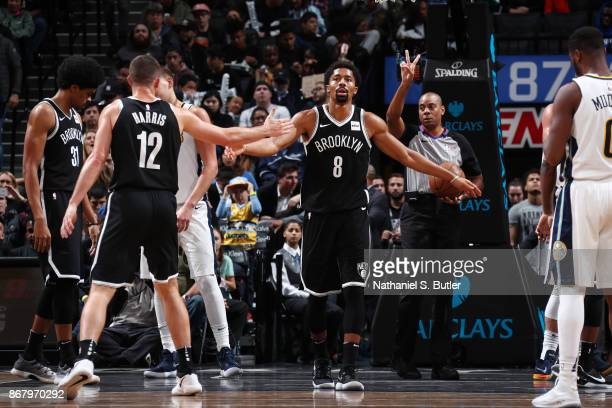 Spencer Dinwiddie of the Brooklyn Nets gives high five to Joe Harris of the Brooklyn Nets during the game against the Denver Nuggets on October 29...