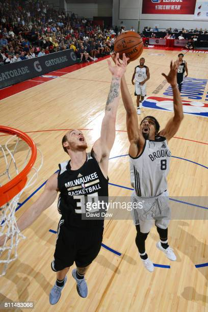 Spencer Dinwiddie of the Brooklyn Nets goes for the rebound against Reggie Upshaw of the Milwaukee Bucks during the 2017 Las Vegas Summer League on...