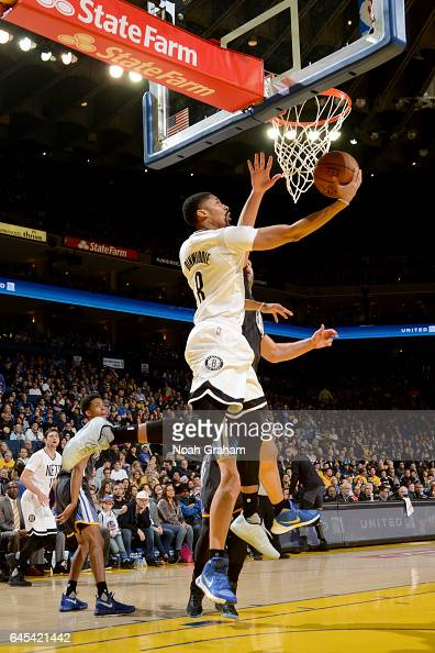 Spencer Dinwiddie of the Brooklyn Nets goes to the basket against the Golden State Warriors on February 25 2017 at ORACLE Arena in Oakland California...