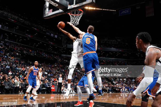 Spencer Dinwiddie of the Brooklyn Nets goes to the basket against the New York Knicks during a preseason game on October 8 2017 at Barclays Center in...