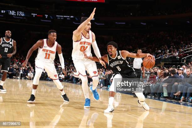 Spencer Dinwiddie of the Brooklyn Nets handles the ball against Enes Kanter of the New York Knicks during the preseason game on October 3 2017 at...