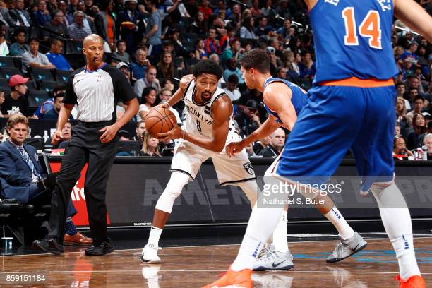 Spencer Dinwiddie of the Brooklyn Nets handles the ball against the New York Knicks during a preseason game on October 8 2017 at Barclays Center in...