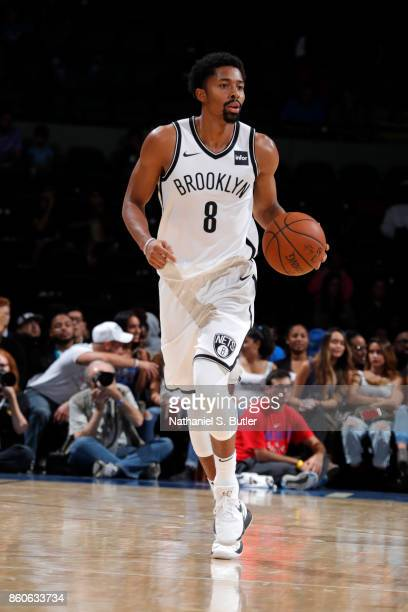 Spencer Dinwiddie of the Brooklyn Nets handles the ball against the Philadelphia 76ers on October 11 2017 at Nassau Veterans Memorial Coliseum in...