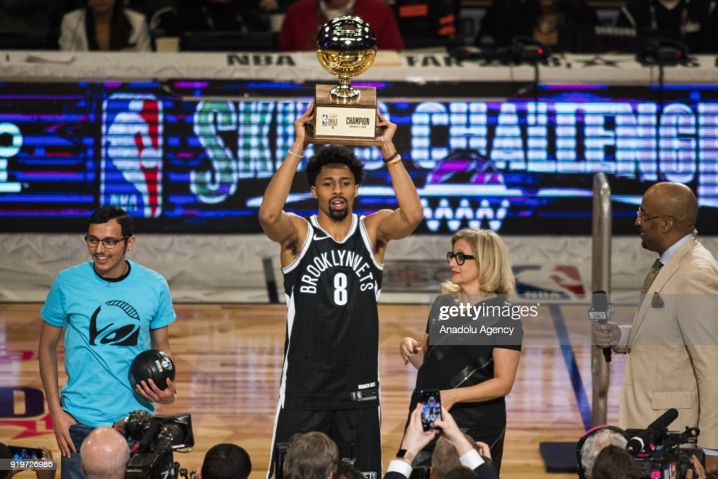 Spencer Dinwiddie #8 of the Brooklyn Nets holds the trophy after winning the Taco Bell Skills Contest, during State Farm All-Star Saturday Night, as part of All-Star Weekend at the Staples Center in Los Angeles, California on February 17, 2018.
