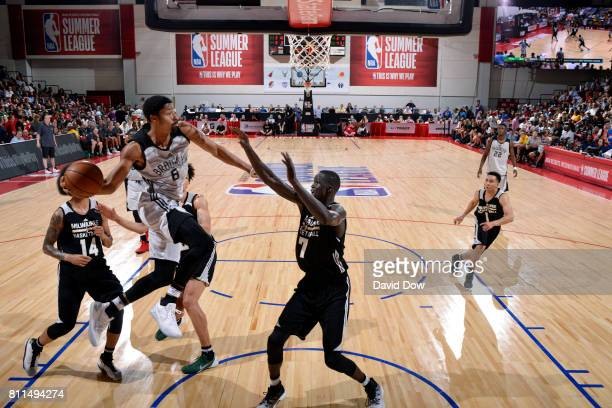 Spencer Dinwiddie of the Brooklyn Nets looks to pass the ball against Thon Maker of the Milwaukee Bucks during the 2017 Las Vegas Summer League on...