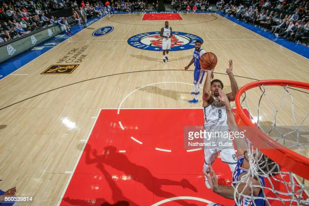 Spencer Dinwiddie of the Brooklyn Nets shoots the ball during the preseason game against the Philadelphia 76ers on October 11 2017 at Nassau Veterans...