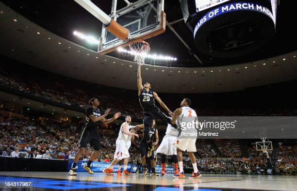 Spencer Dinwiddie of the Colorado Buffaloes lays up during the second round of the 2013 NCAA Men's Basketball Tournament against the Illinois...