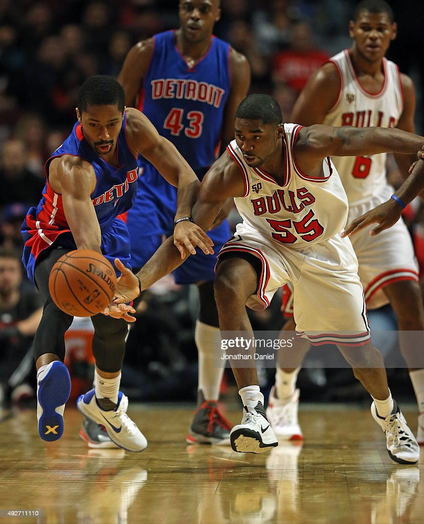 Spencer Dinwiddie #8 of the Detroit Pistons and E'Twaun Moore #55 of the Chicago Bulls chase a loose ball during a preseason game at the United Center on October 14, 2015 in Chicago, Illinois. The Pistons defeated the Bulls 114-91. Note to User: User expressly acknowledges and agrees that, by downloading and or using the photograph, User is consenting to the terms and conditions of the Getty Images License Agreement.
