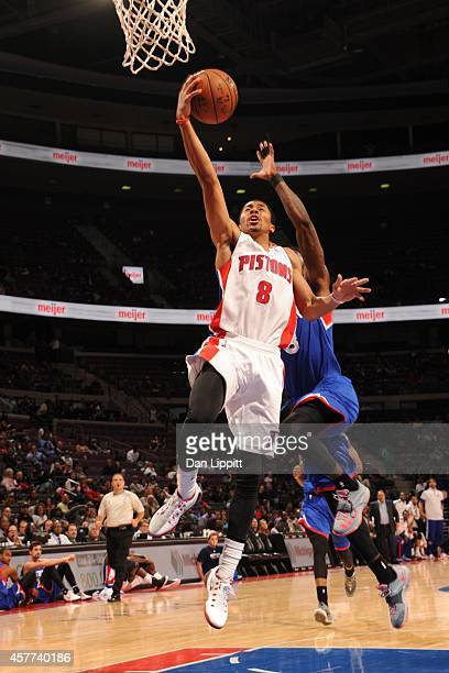 Spencer Dinwiddie of the Detroit Pistons goes to the basket against the Philadelphia 76ers on October 23 2014 at The Palace of Auburn Hills in Auburn...