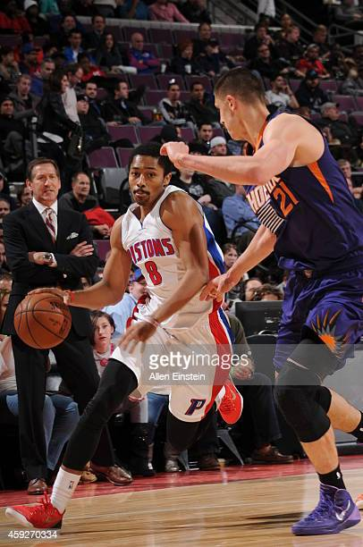 Spencer Dinwiddie of the Detroit Pistons handles the ball against the Phoenix Suns during the game on November 19 2014 at The Palace of Auburn Hills...
